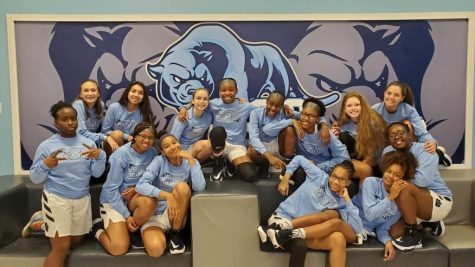 "Smiles emerge as player for the CSC girls Basketball team get ready to play a home game last year. Lead by head coach Kate Hearn, the Panthers hope to seek a win. ""This team is special and they have what it takes to win"" former student Kirsten Woods said."